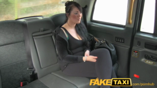Voluptuous brunette is fucking a taxi driver in his car, while no one is watching them