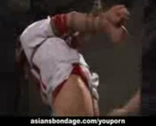 Hot Asian cheerleader enjoys a round of bdsm